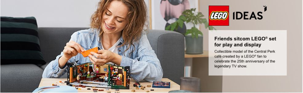 woman playing with lego set