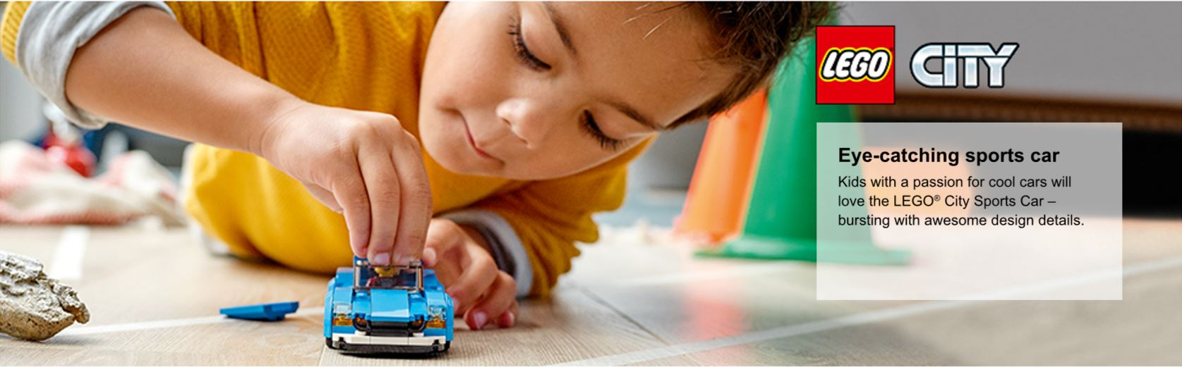 boy playing with sports car