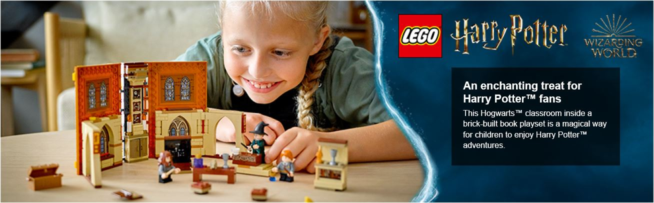 Child playing with harry potter lego on a table