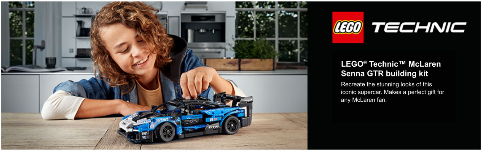 child playing with lego car model