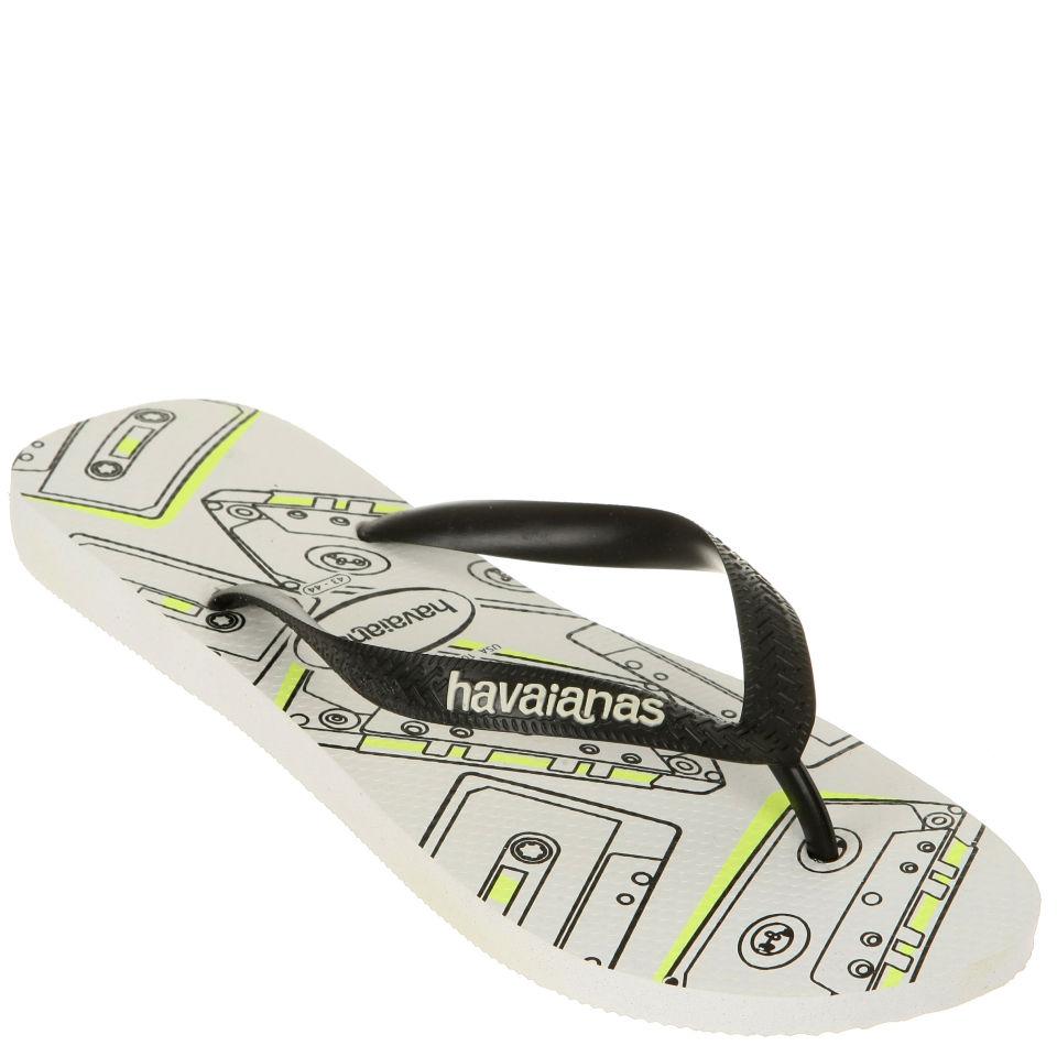 e6061a242c8c Havaianas Unisex 4 Nite Flip Flops - White Black. Description
