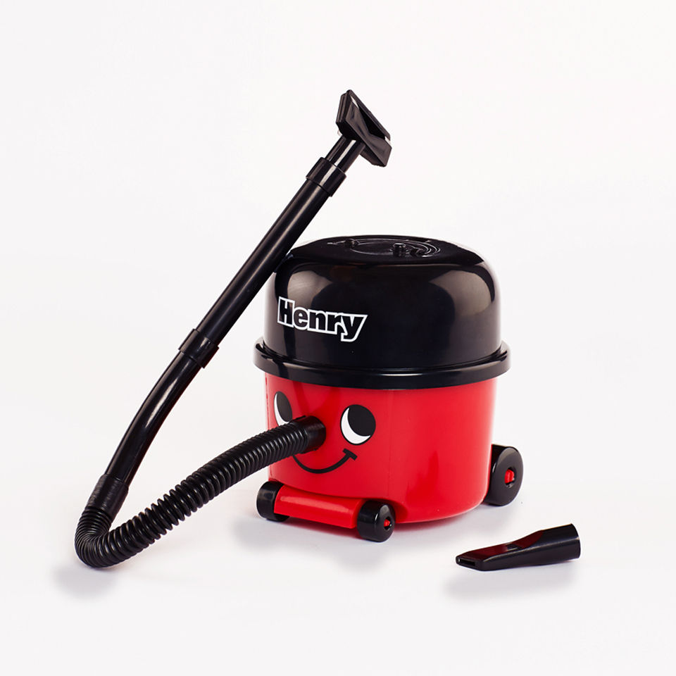 Image of a mini Henry Hoover with its extra hose nozzle placed next to it