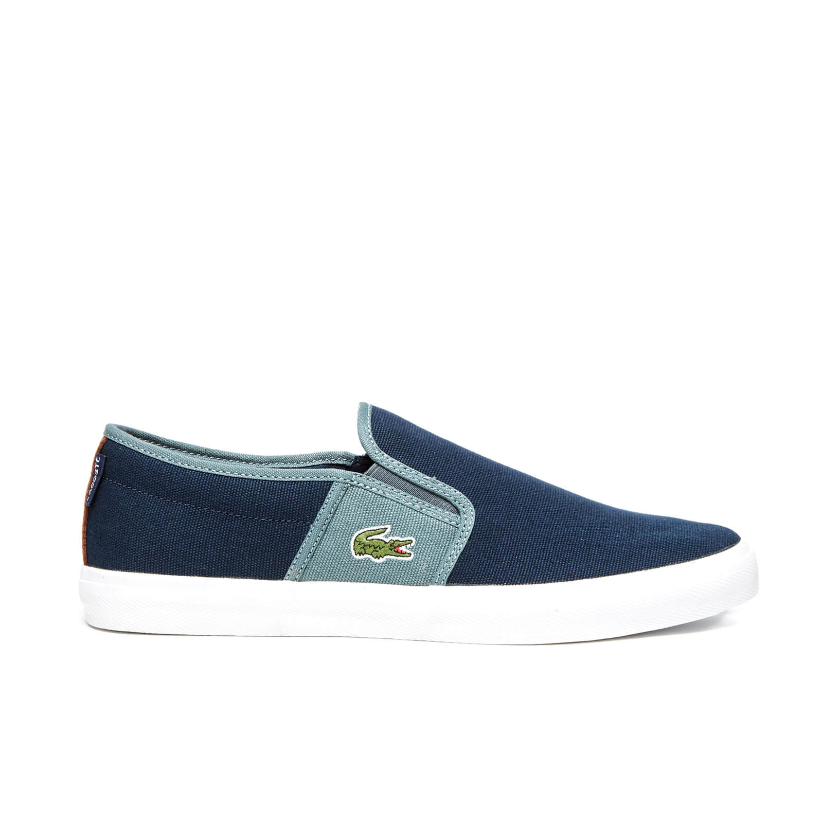 5b0c1f1fa4734d Lacoste Men s Gazon Sport SEP Canvas Slip On Trainers - Dark Blue Grey -  Free UK Delivery over £50