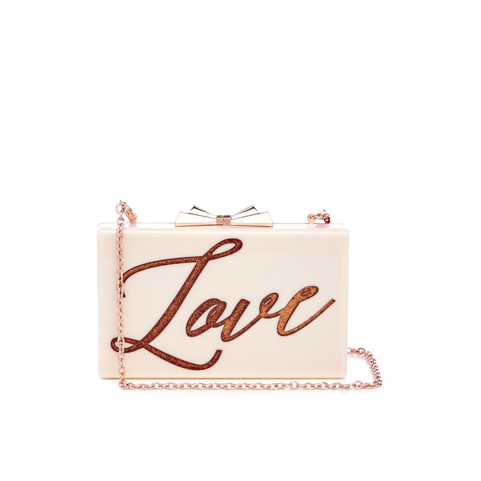 5a3af96de Ted Baker Women s Siann Glitter Word Resin Clutch Bag - Natural Womens  Accessories