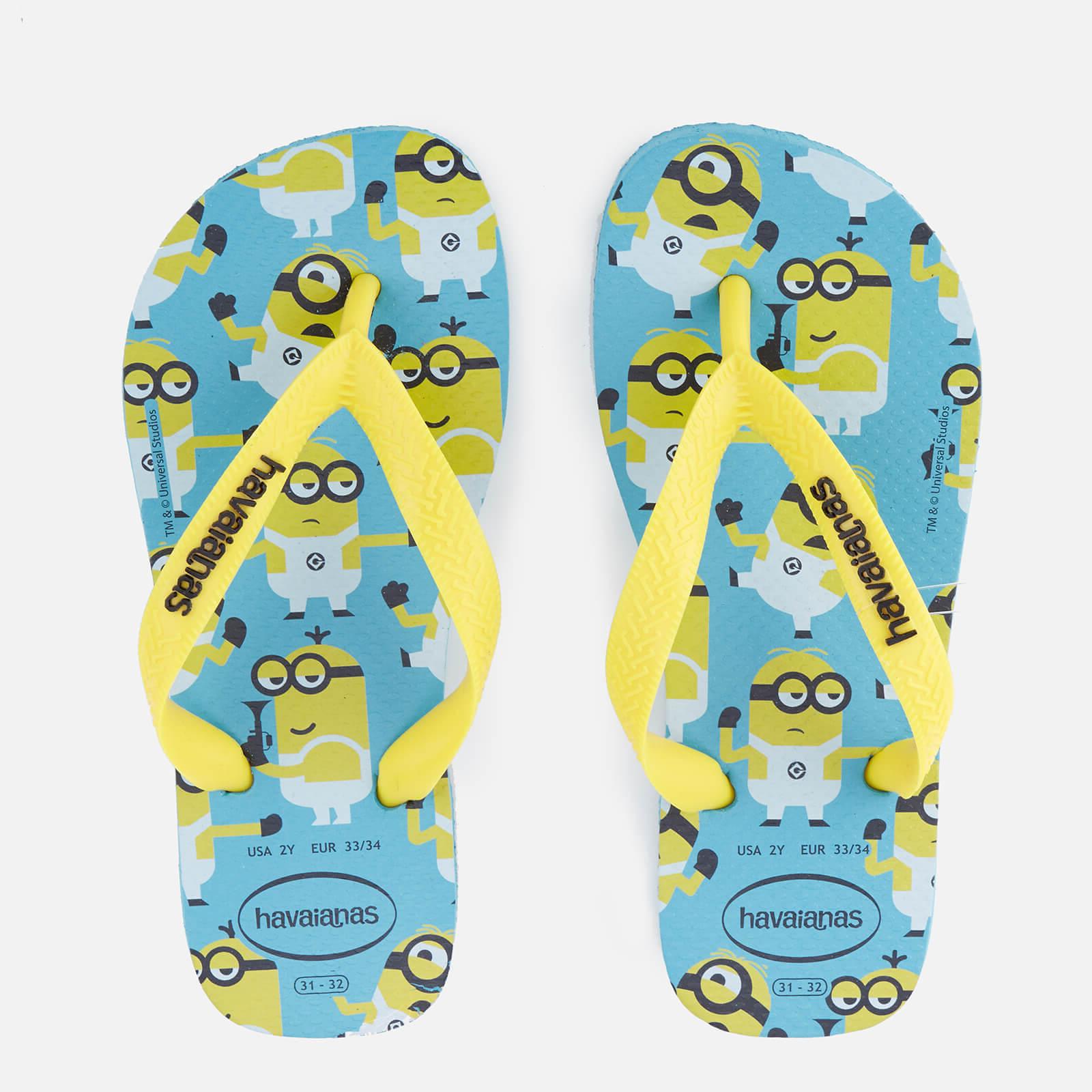 180b6899076a51 Havaianas Kids' Minions Flip Flops - Blue | FREE UK Delivery | Allsole