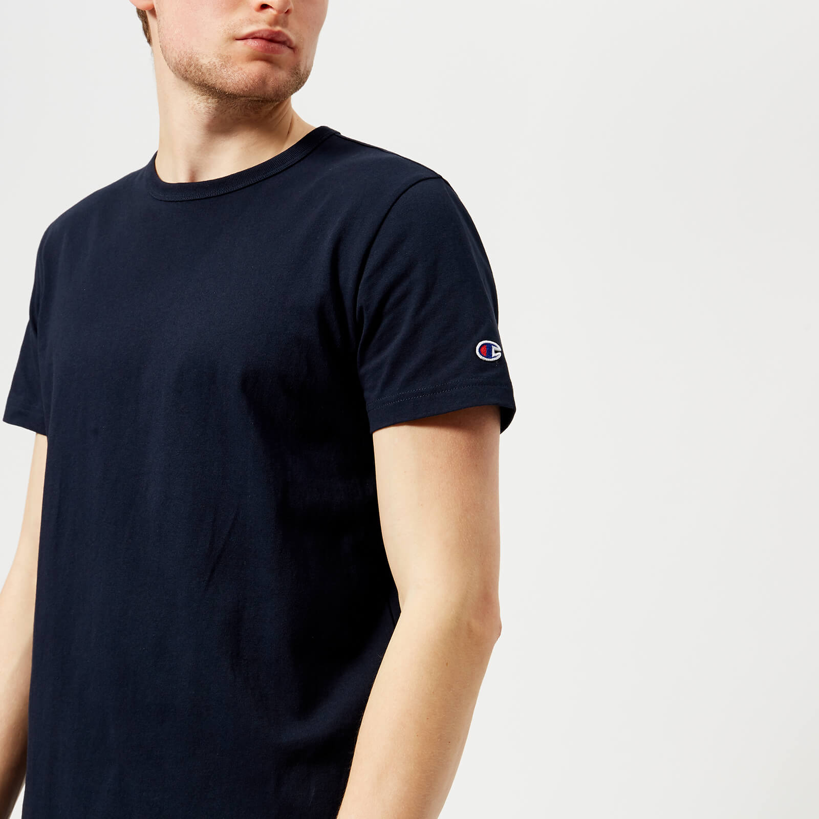 5252029a5e53f Champion Men s Short Sleeve Logo T-Shirt - Navy - Free UK Delivery over £50