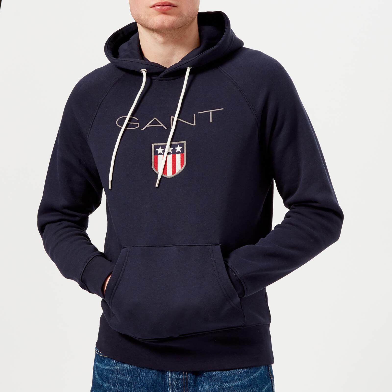 718d96e46a3 GANT Men's Shield Logo Hoodie - Evening Blue Mens Clothing   TheHut.com