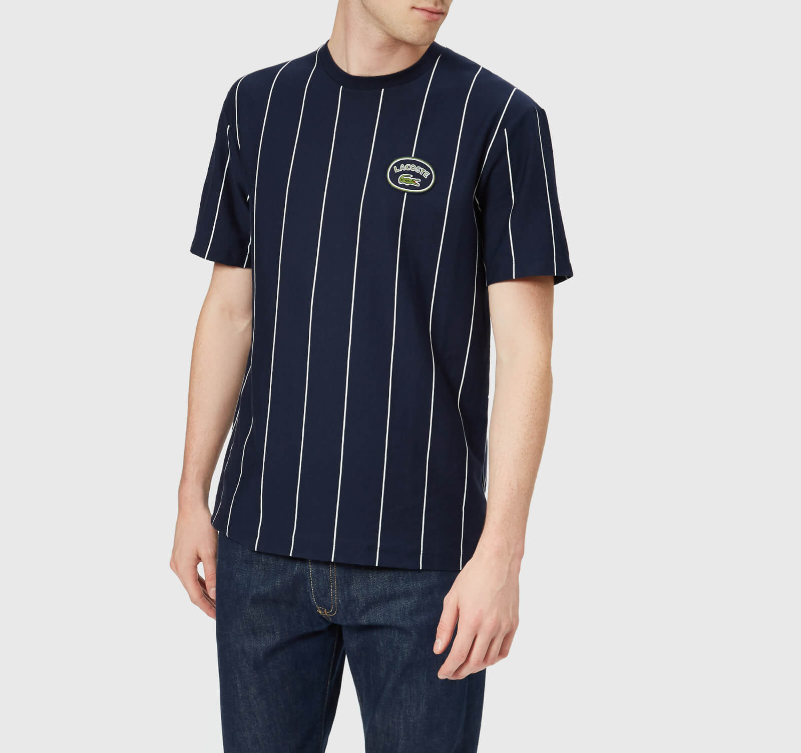 b3fe47eadc02a Lacoste Men s Vertical Stripe Patch Logo T-Shirt - Navy White - Free UK  Delivery over £50