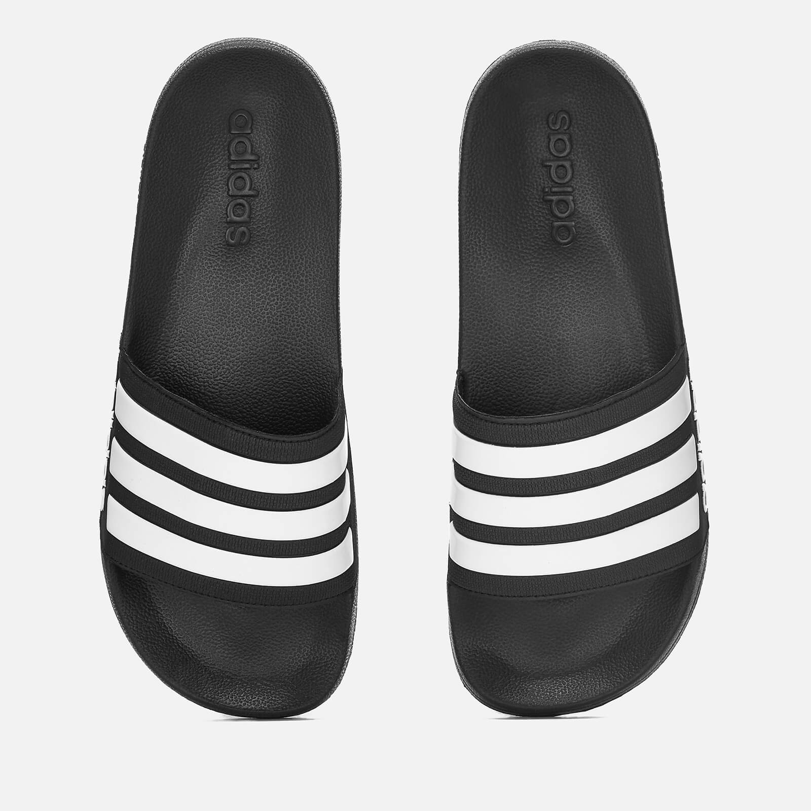 sports shoes 20777 8a109 adidas Men s Adilette Shower Slide Sandals - Black   ProBikeKit.com