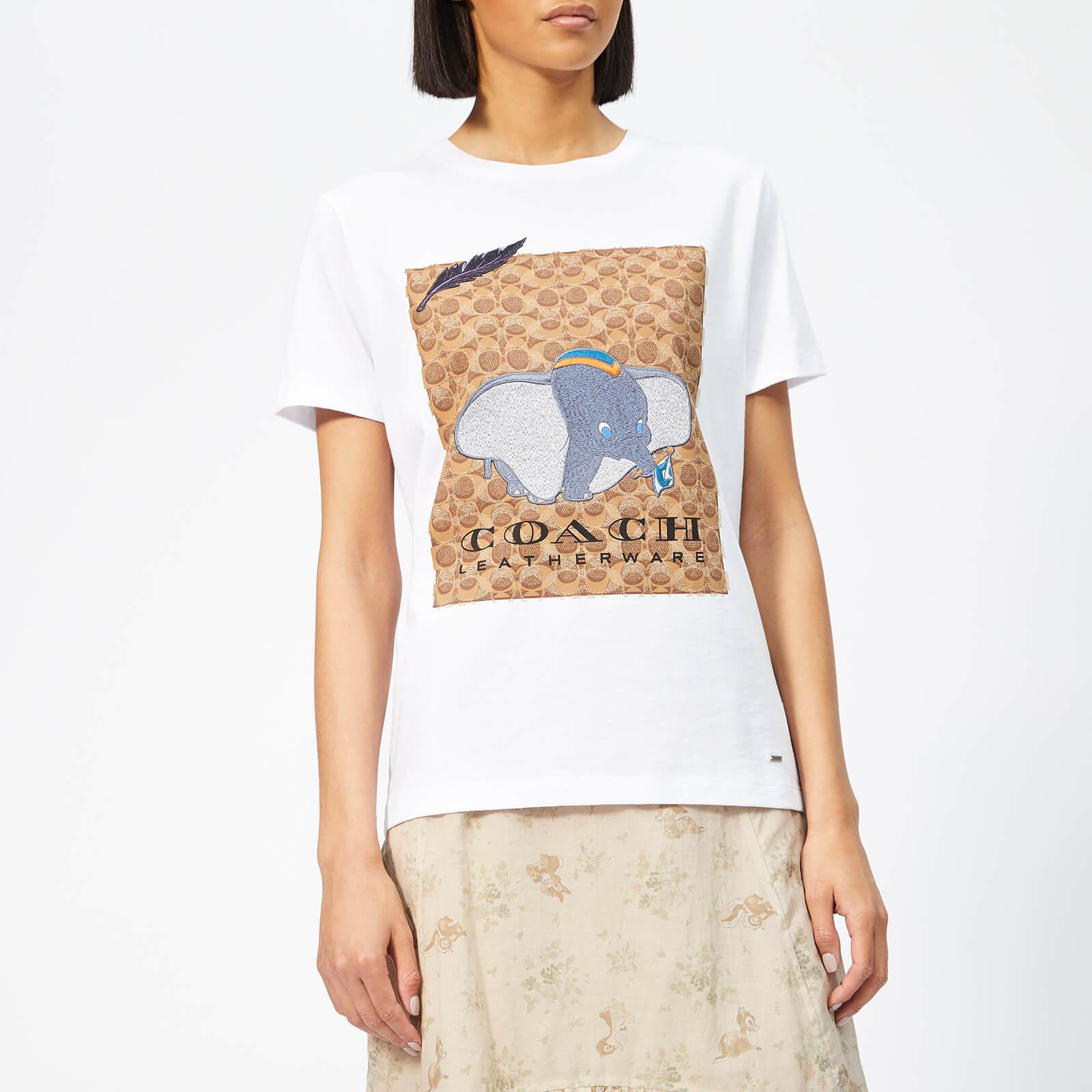 7e20a6ff7e3ed Coach 1941 Women's X Disney Dumbo Signature T-Shirt - Optic White - Free UK  Delivery over £50