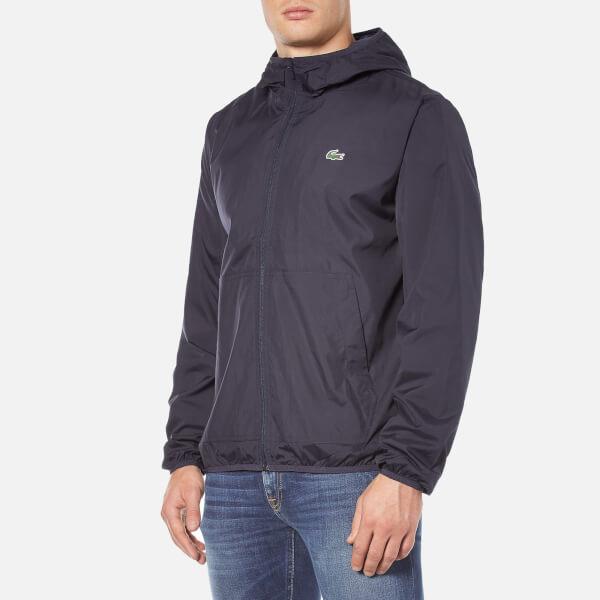 Lacoste Men's Showerproof Lightweight Jacket - Navy Blue - Free UK ...