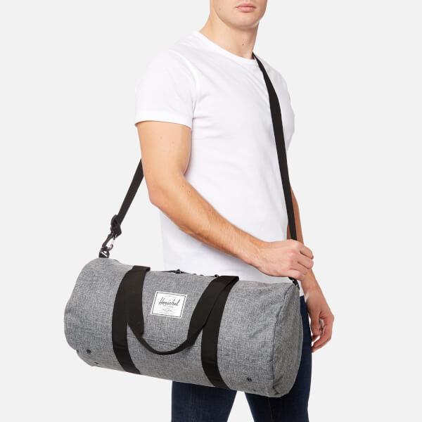 57d2ece00a0b Herschel Supply Co. Men s Sutton Mid-Volume Duffle Bag - Raven  Crosshatch Black
