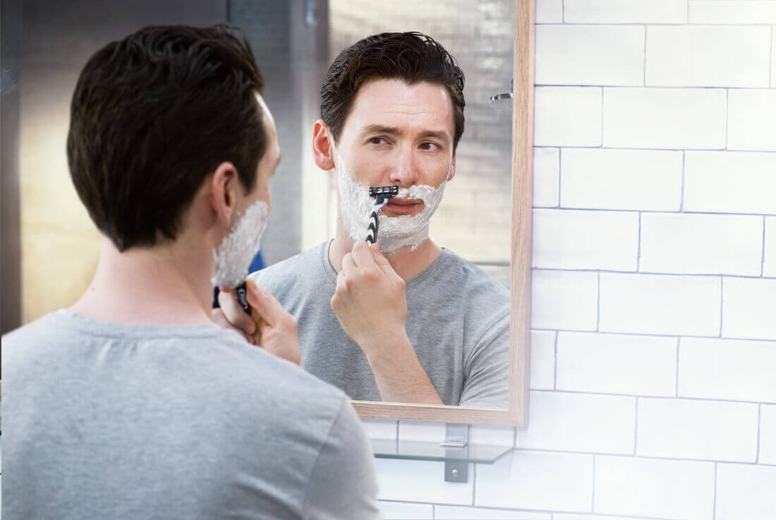 Man shaving with Gillette Mach3 razor