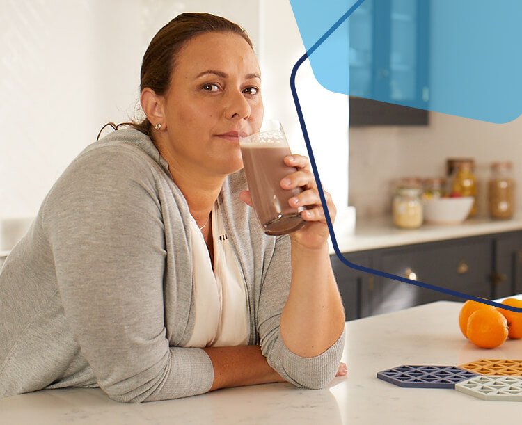 Image of a woman enjoying an OPTIFAST drink