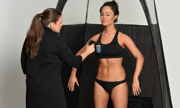 woman receiving a spray tan