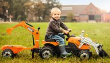 Young boy on a toy tractor