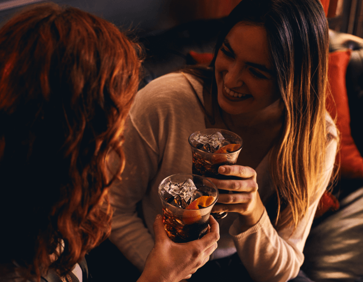 Friends celebrating with alcoholic drinks