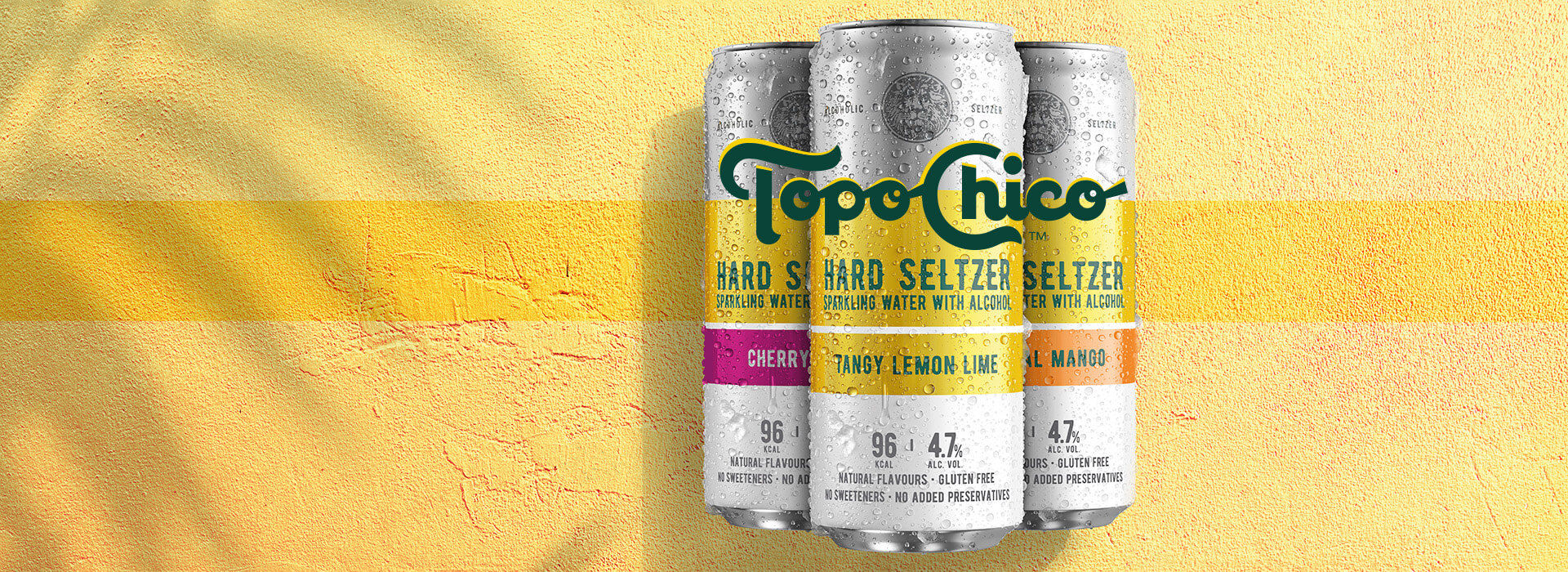 Three cool cans of Topo Chico Hard Seltzer