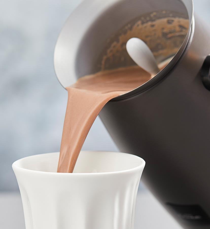 Velvetiser machine serving a hot chocolate.