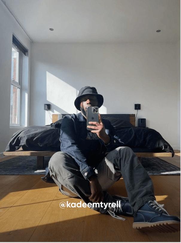 man sat down taking a photo - Visit Kickers Instagram