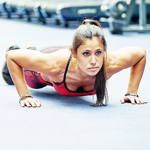 woman in the gym doing a press up