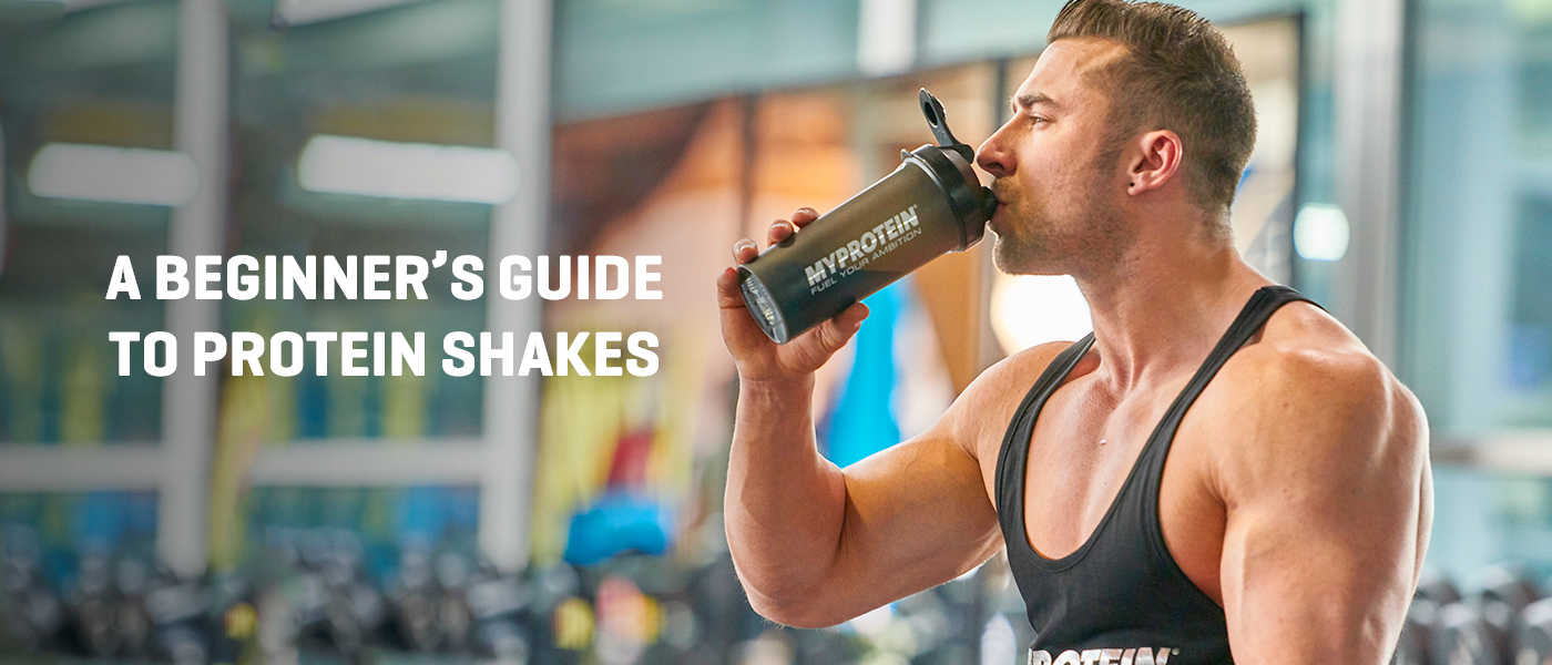 male bodybuilder drinking a protein shake