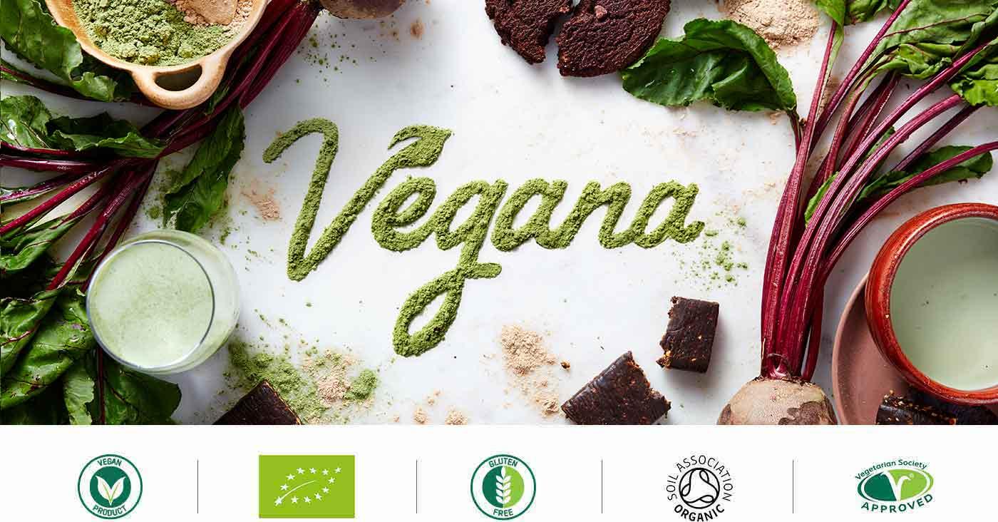 la gama vegana con alimentos saludables, polvos, y vegetales alrededor del titulo