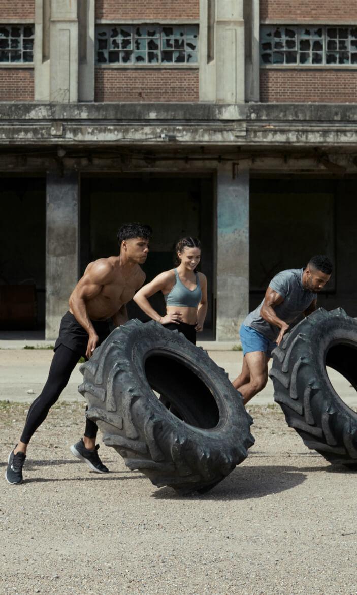 Men pushing tyre