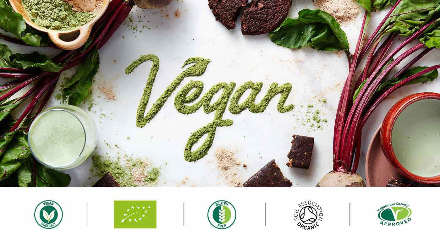 the vegan range with healthy foods, powders and green vegetables around the outside of the title