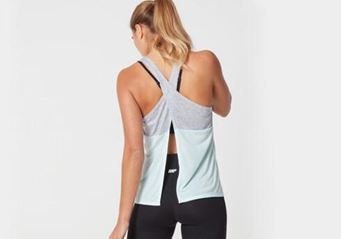 kobiet modelu noszenie sportowego wydajność top i legginsy