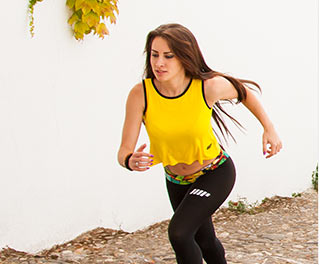 women running up steps in myprotein sports clothing