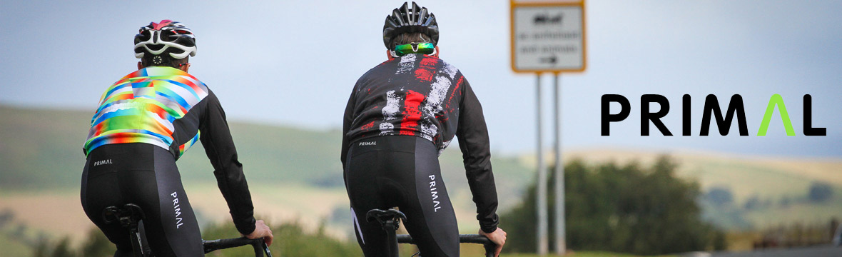 image of the back of two cyclists wearing colourful Primal jerseys