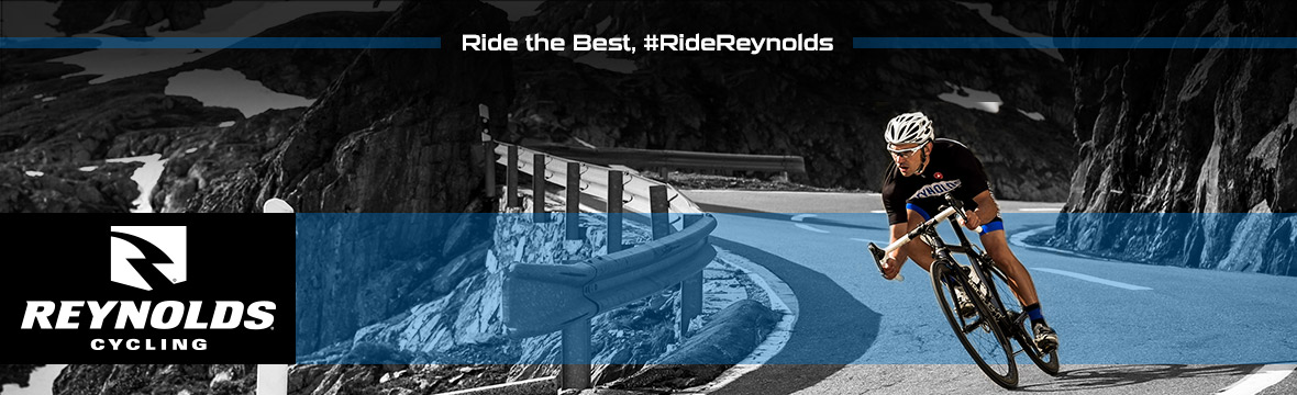 reynolds cycling logo to the left of an image of a cyclist riding toward the camera at speed