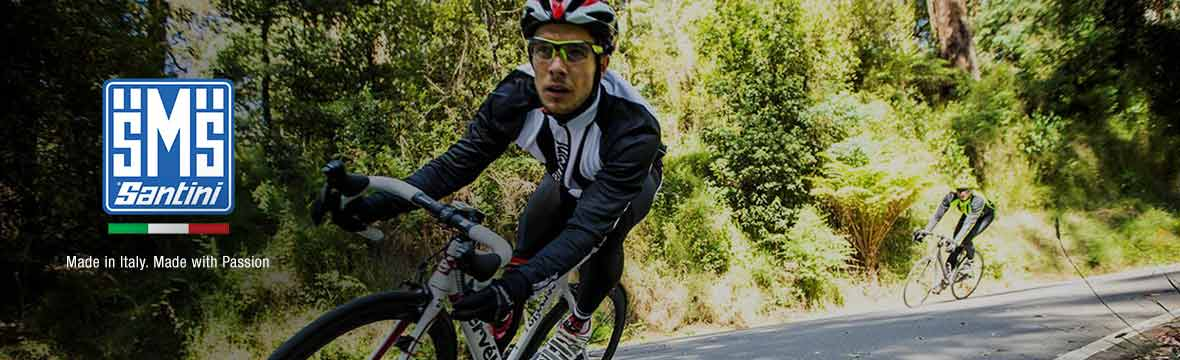 image of a cyclist wearing santini kit, cycling towards the camera