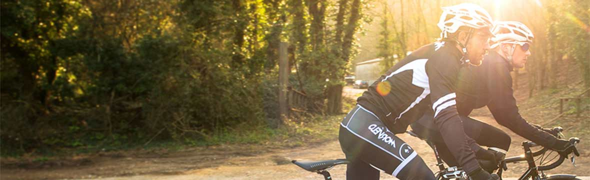 Two cyclists riding in Autumn