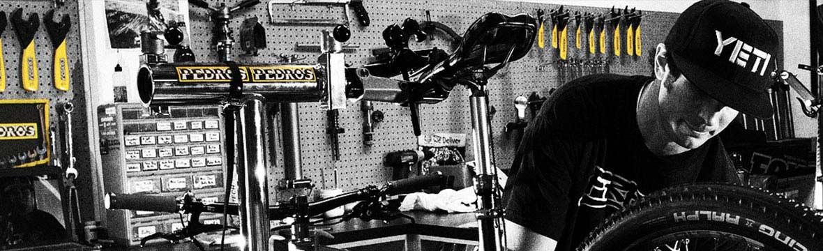 Cyclist working in a bike workshop