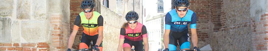 Cyclist wearing the Alé R-EV1 Master Short Sleeve Jersey - Black/Yellow/Orange