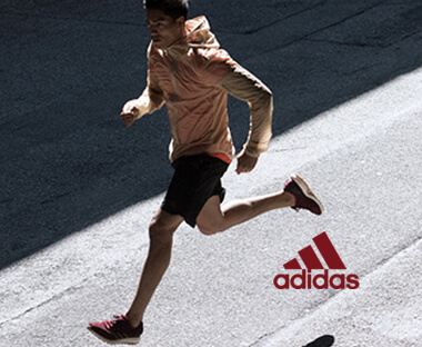 Female runner wearing torquoise adidas running apparel
