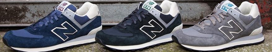 three new balance trainers from left to right in navy, black and grey