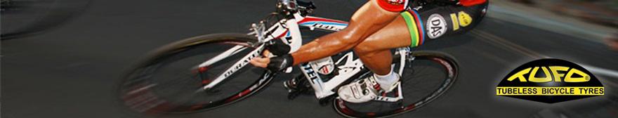 cyclist riding around a sharp bend