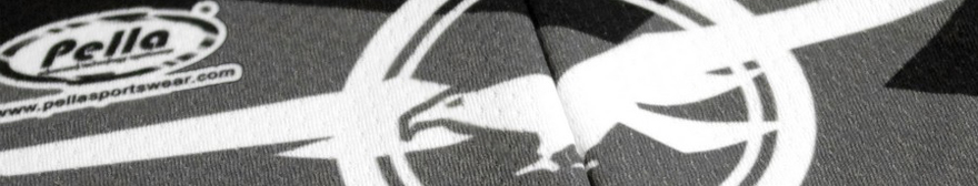 close-up black and white image of a pella cycling jersey's material around the zip, with the logo in view on the left