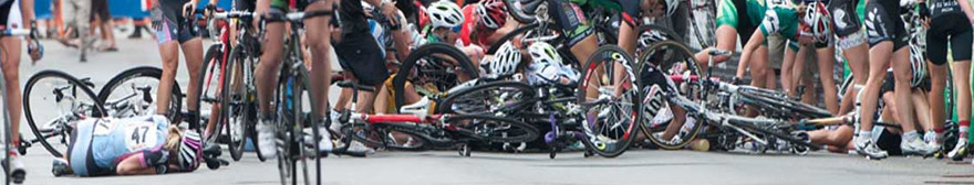 a crash in a peloton of cyclists, with several people and bikes on the floor