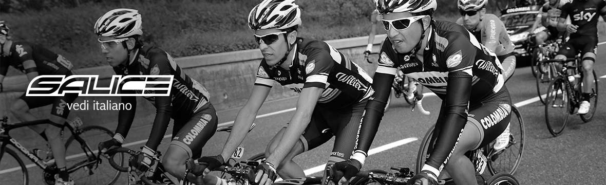 a black and white image of a peloton of cyclists wearing salice sunglasses