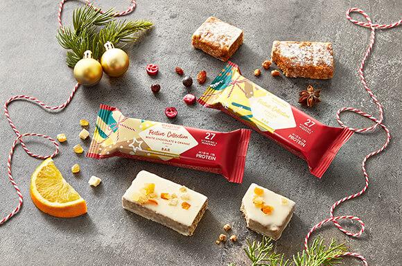 exante Weihnachtskollektion, inklusive Christstollen Riegel und Weiße Schokolade und Orange Riegel